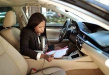 woman in black blazer sitting on drivers seat